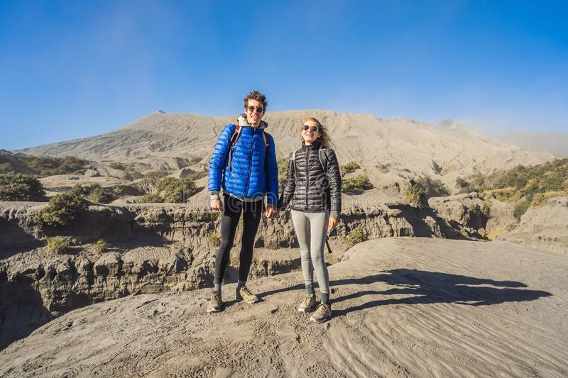 Young couple man and woman visit the Bromo volcano at the Tengger Semeru National Park on the Java Island, Indonesia. Young couple men and women visit the Bromo royalty free stock photo