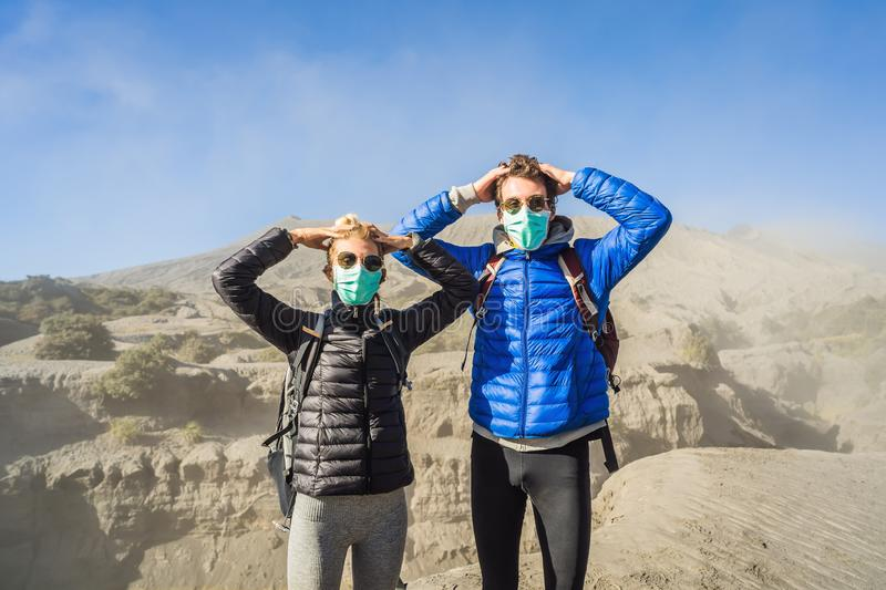 Young couple man and woman visit the Bromo volcano at the Tengger Semeru National Park on Java Island, Indonesia. They. Young couple men and women visit the royalty free stock image