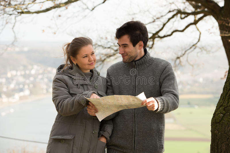 Young couple with map stock image