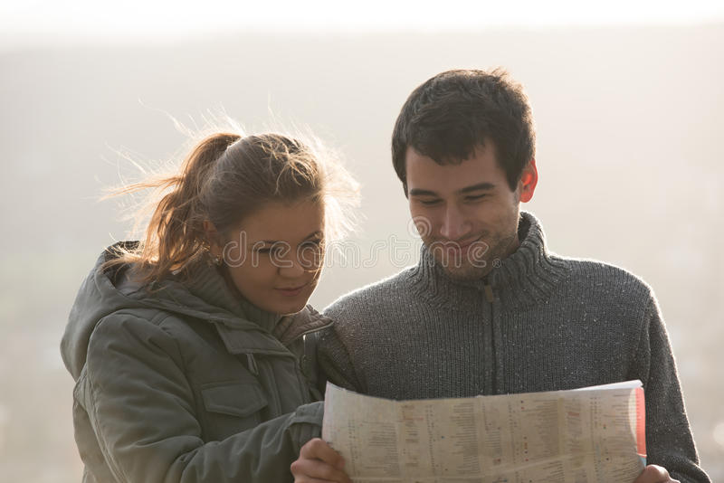 Young couple with map stock photography