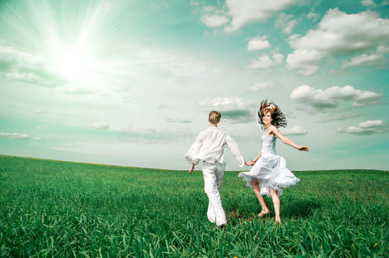 Young couple in meadow. Wedding day. young couple in meadow royalty free stock photography