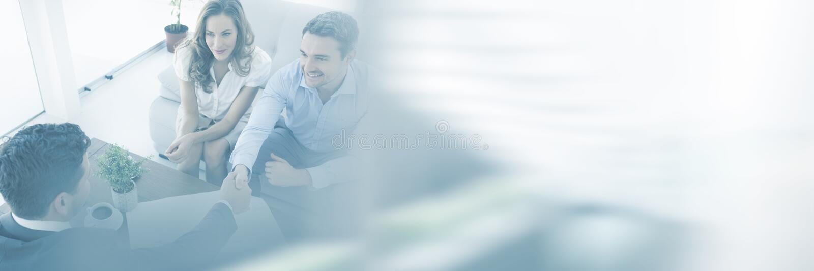 Young couple in meeting with a financial adviser royalty free stock image