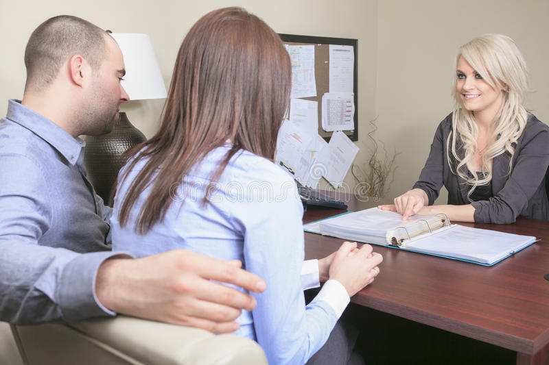 Young couple in a meeting - insurance or bank for royalty free stock photo