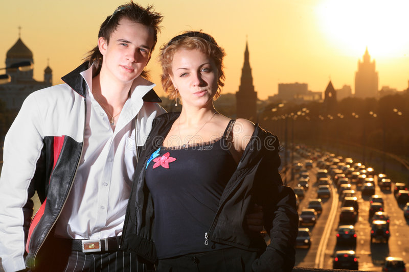 Young couple Moscow. Young couple in Moscow city at sunset stock photography