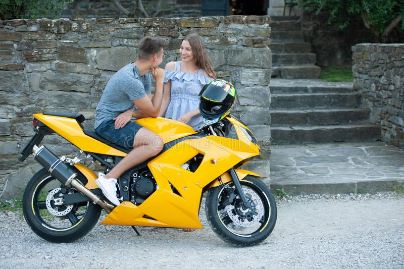 Young couple on a motor bike on a late summer afternoon royalty free stock photos