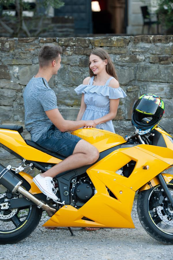 Young couple on a motor bike on a late summer afternoon royalty free stock images
