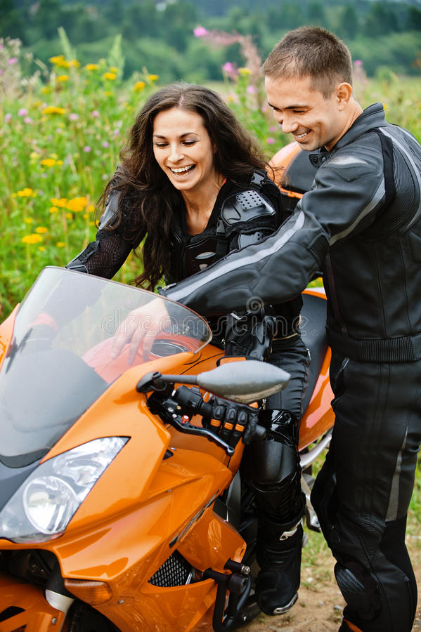 Download Young Couple With Motorbike Stock Image - Image: 20806497