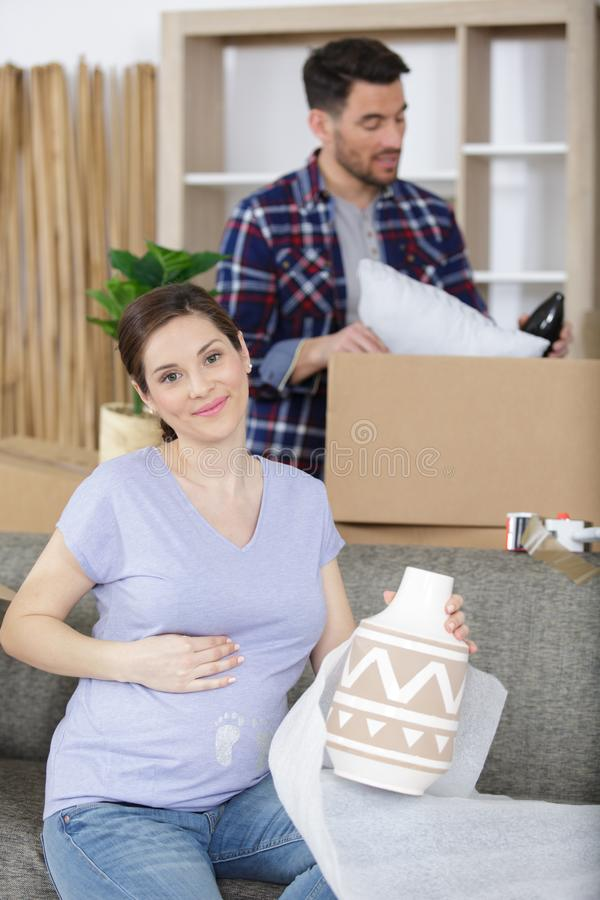 Young couple moving to new flat with fragile things stock photos