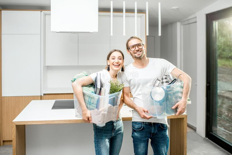 Young couple moving to a new modern house stock images