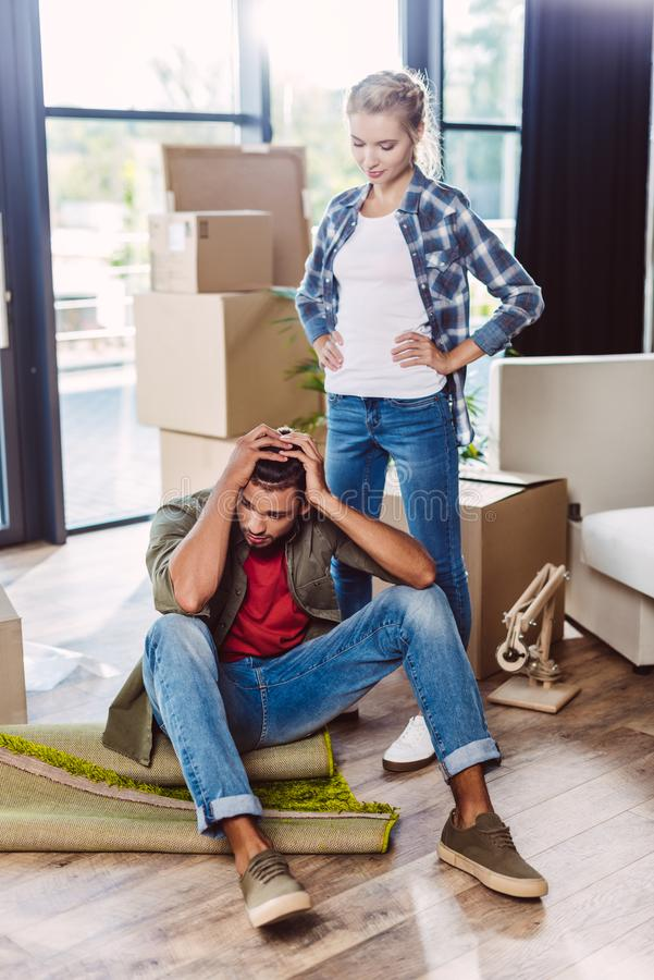 Young couple in new apartment royalty free stock image