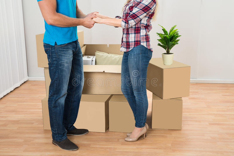 Young Couple In New Home. Close-up Of Young Couple In New Home Holding Hands stock photos