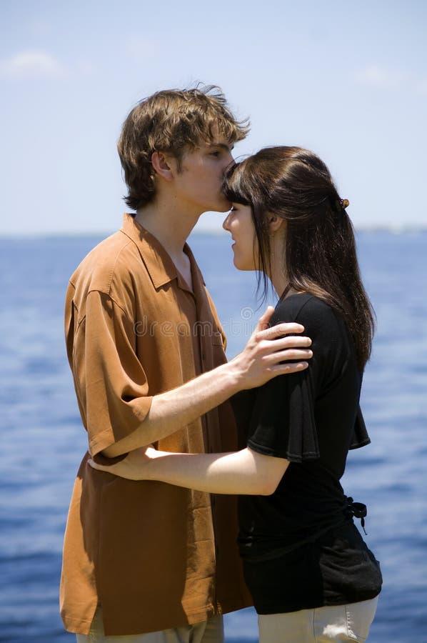 Young couple by ocean stock photos