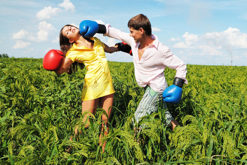 Young couple at odds. Young couple fighting because they at odds royalty free stock image