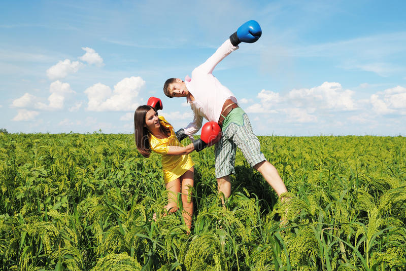 Young couple at odds. Young couple in fighting because they at odds royalty free stock photography