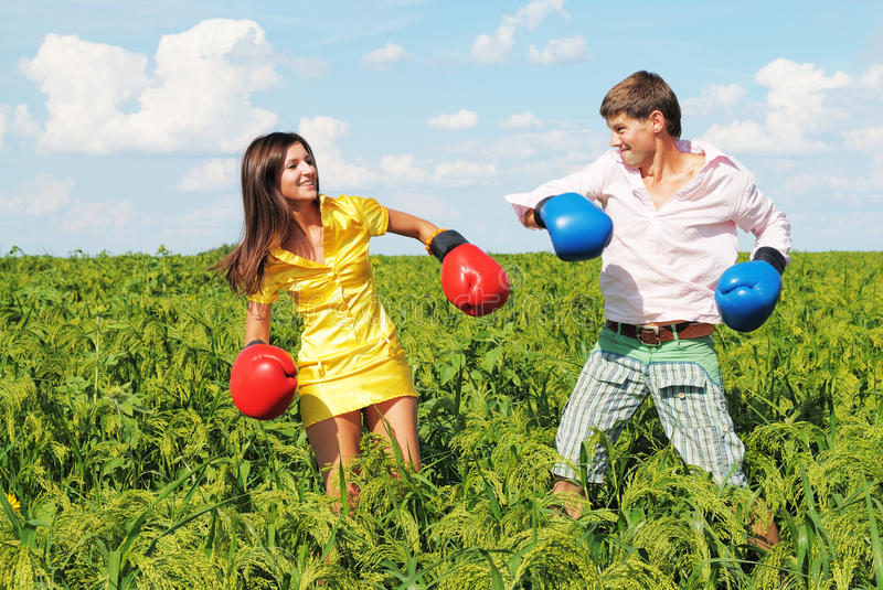 Young couple at odds. Young couple in fighting because they at odds stock photography