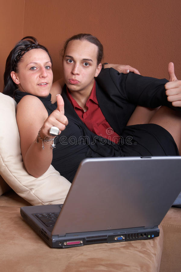 Download Young couple online stock photo. Image of black, couch - 9538936