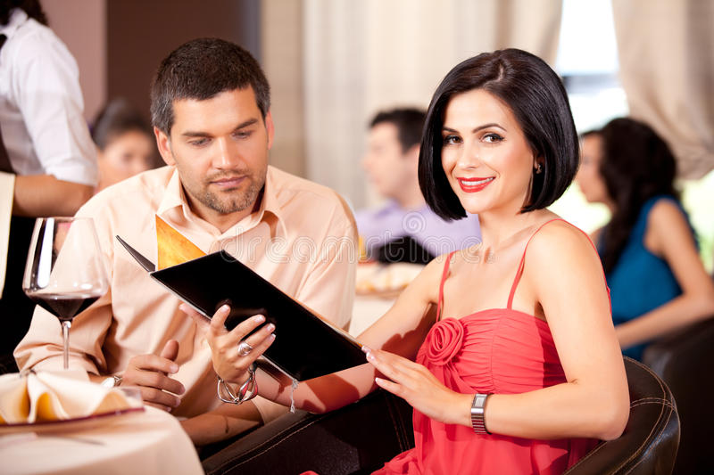 Download Young Couple Ordering Food Restaurant Table Stock Image - Image: 20681395