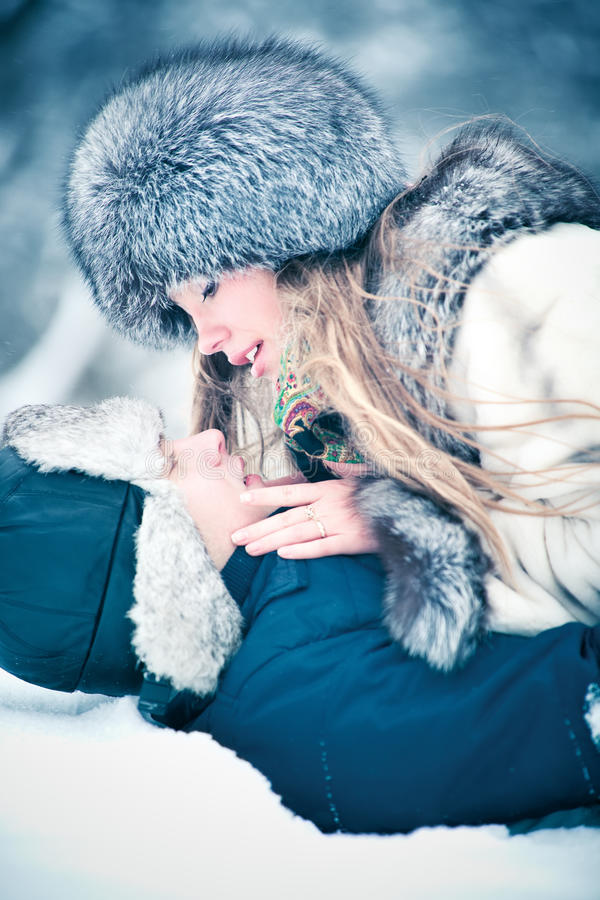 Young couple outdoors winter portrait. Soft blue tint stock photo
