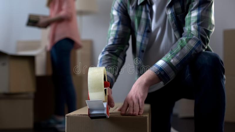 Young couple packing their things in boxes, moving from dormitory to own house. Stock photo royalty free stock images