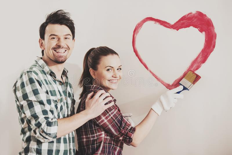 Young couple painting wall royalty free stock photos