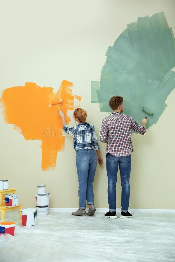 Young couple painting wall. Home repair royalty free stock photos
