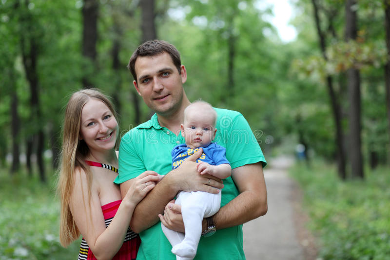young couple parent with baby boy stock image