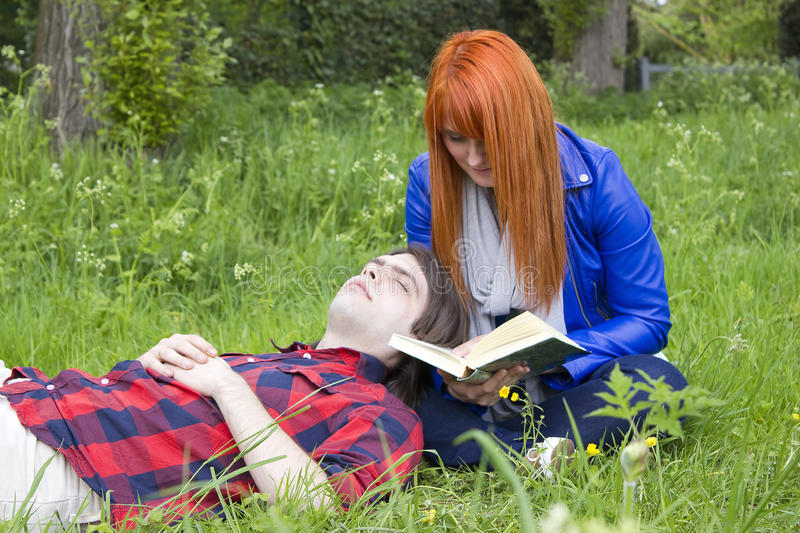 Young couple in the park stock photo