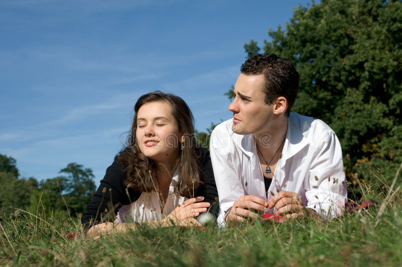 Young couple at park stock photo