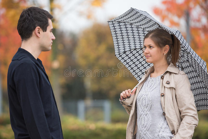 Young couple in park stock images