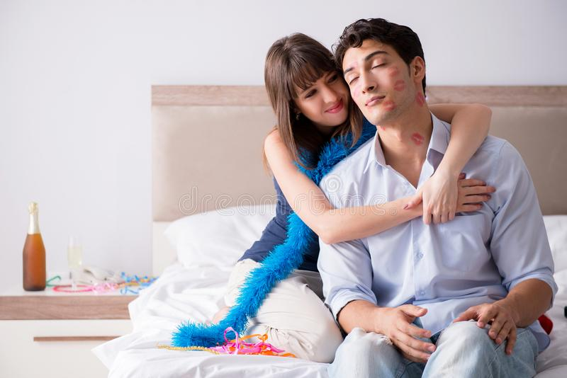 The young couple partying in the bed stock photos
