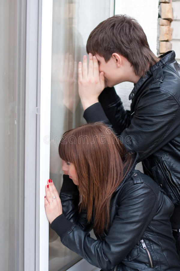 Download Young Couple Peeping In Window Stock Photo - Image: 16264364