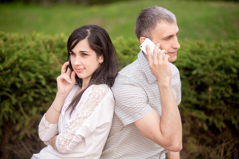 Young couple on phone stock photos