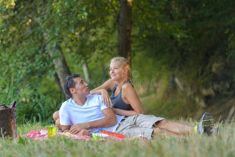 Young couple at picnic. A young couple at picnic stock photo