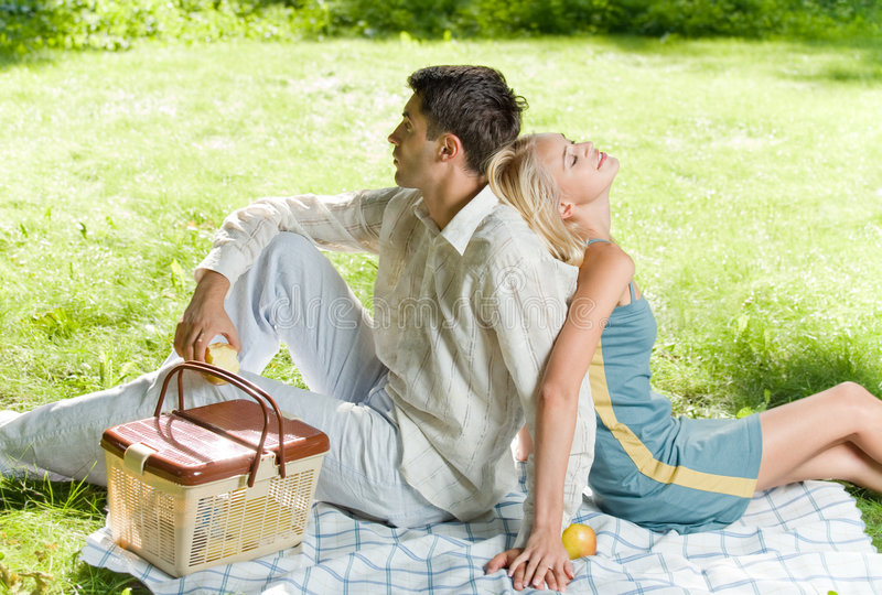 Young couple at picnic. Young couple together at picnic, outdoors royalty free stock photos