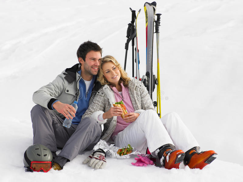 Young Couple With Picnic On Ski Vacation stock images