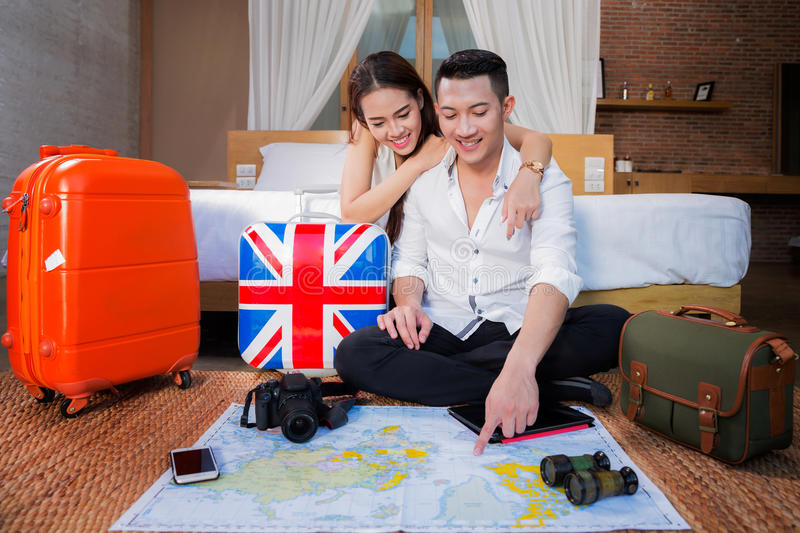 Young couple planning honeymoon vacation trip stock photo