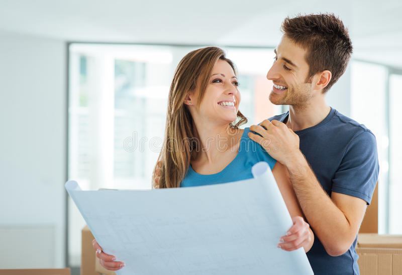 Young couple planning their new house stock photos