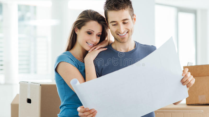 Young couple planning their new house stock image