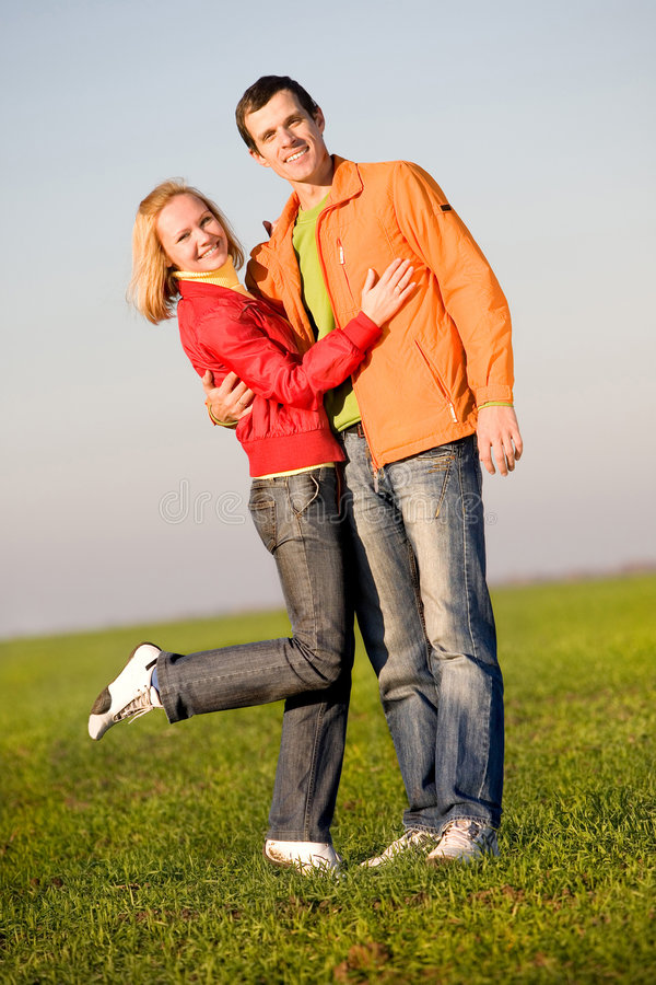 Young couple playing around in the nature.  stock photos