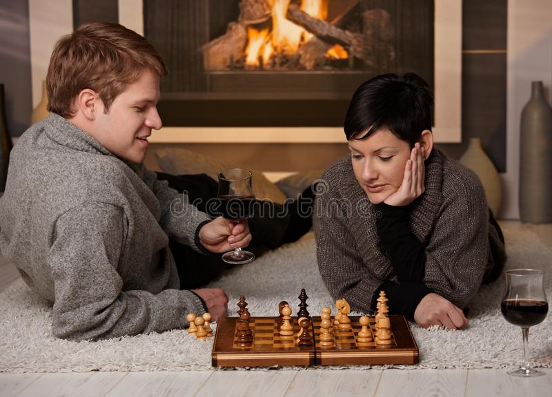 Young couple playing chess stock images
