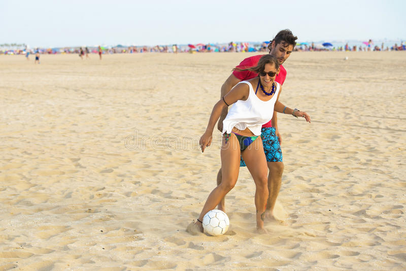 Young couple playing football royalty free stock photos