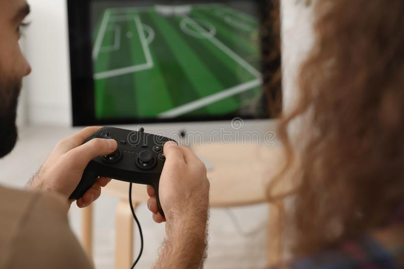 Young couple playing video games at home. Closeup stock images