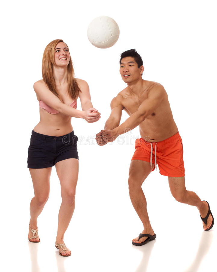 Download Young Couple Playing Volleyball Stock Photo - Image: 29050404
