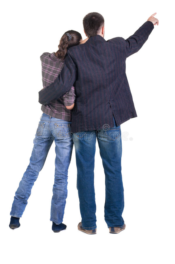 Download Young Couple Pointing At Wall. Rear View. Stock Image - Image: 17332155