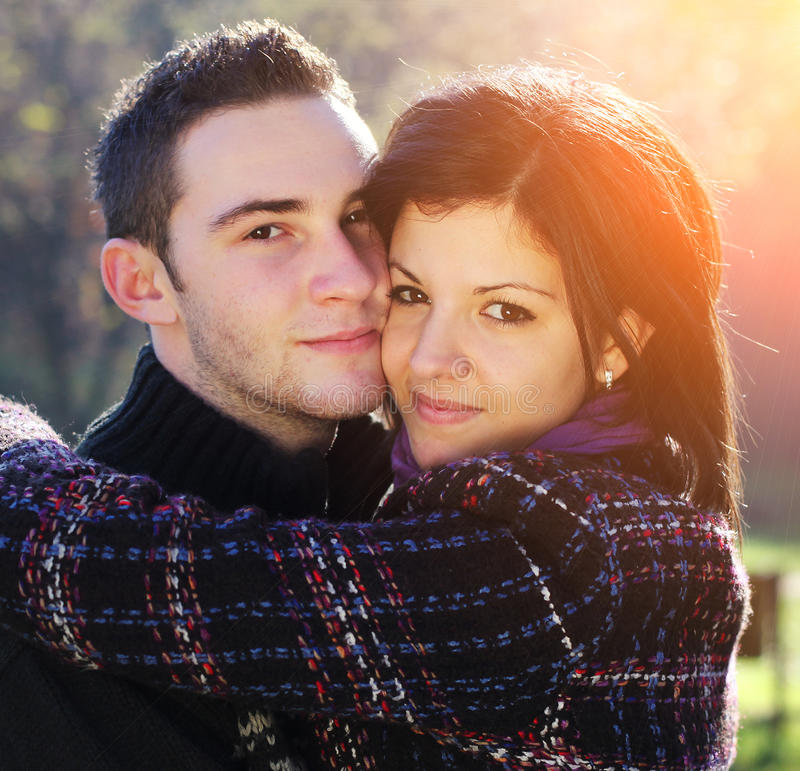 Young couple. Portrait of romantic young couple in autumn outdoor royalty free stock image