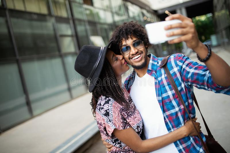 Young african couple pose for holiday selfie in city royalty free stock photo