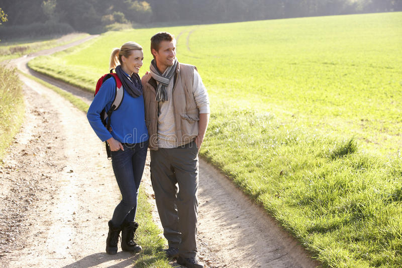 Young couple pose in park stock images