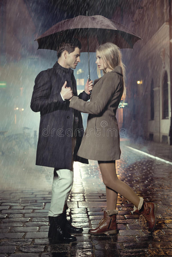 Free Young Couple Posing In Heavy Rain Stock Photo - 34465390