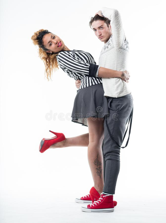 Young couple posing isolated on white stock photography