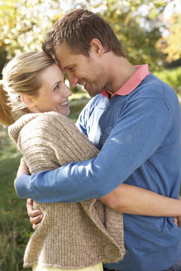 Download Young Couple Posing In Park Stock Photo - Image of looking, having: 17486976